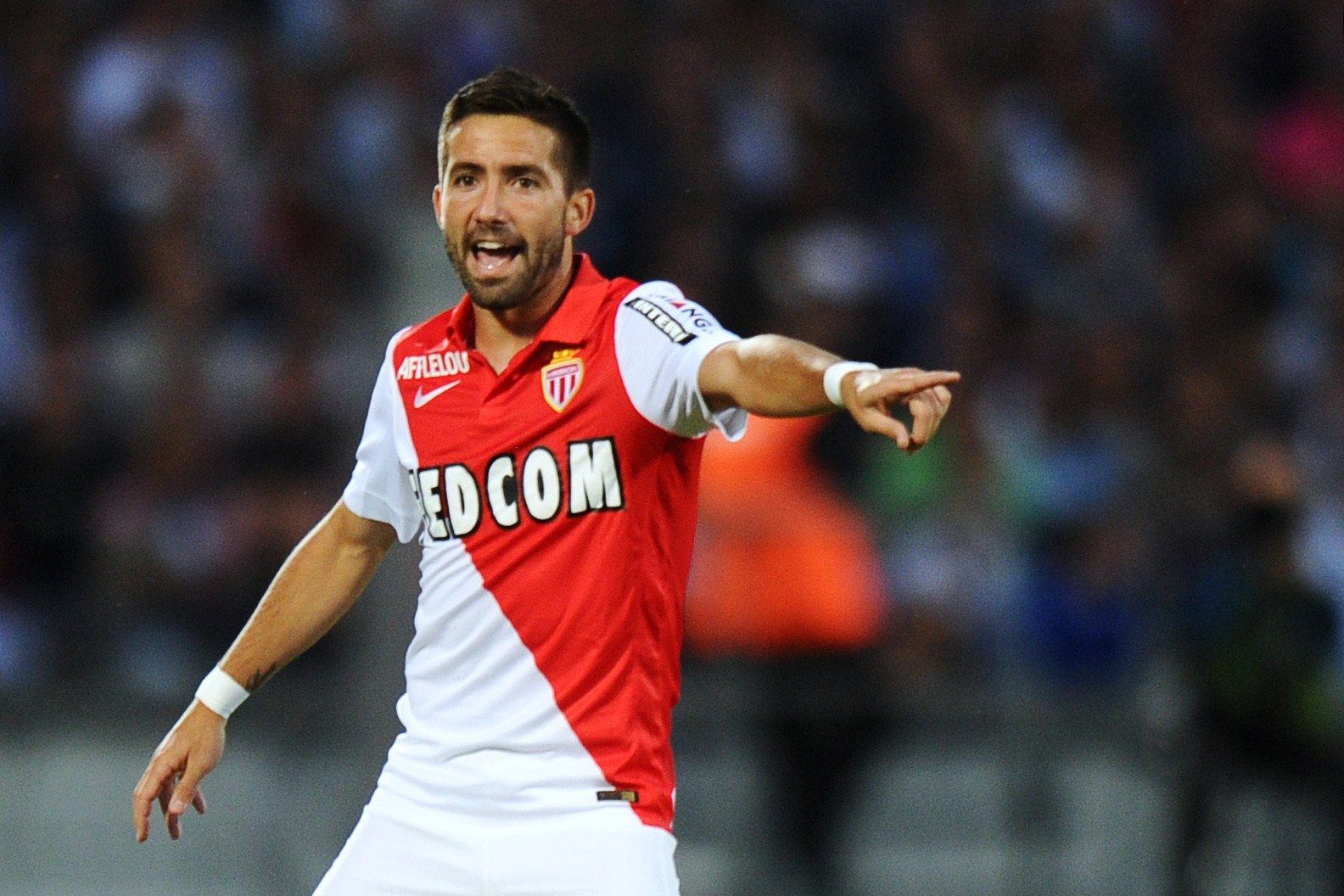 Monaco's Portuguese midfielder Joao Moutinho gestures  during  the French L1 football match between Bordeaux (FCGB) and Monaco (ASM) on August 17, 2014 at the Chaban-Delmas Stadium in Bordeaux, southwestern France. AFP PHOTO / NICOLAS TUCAT        (Photo credit should read NICOLAS TUCAT/AFP/Getty Images)