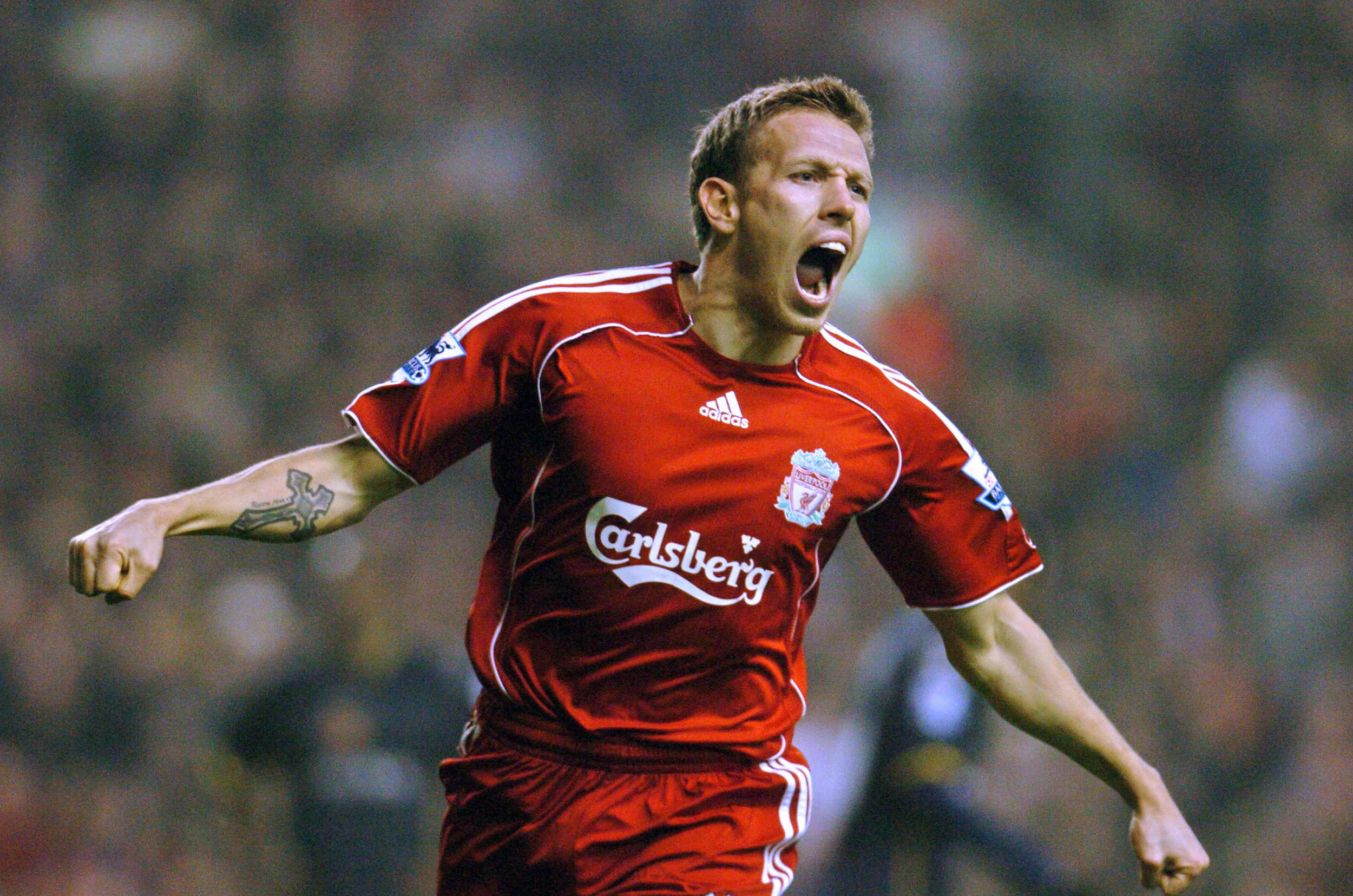 Liverpool, UNITED KINGDOM: (FILES) Craig Bellamy celebrates after scoring against Watford at Anfield, in Liverpool, 23 December 2006. West Ham announced Tuesday 10 July 2007, the signing of Craig Bellamy from Liverpool for a fee of GBP7.5m. (approx 11m euros/15.1m USD) Bellamy has agreed a five year deal. AFP Photo/Paul Barker/FILES (Photo credit should read PAUL BARKER/AFP/Getty Images)
